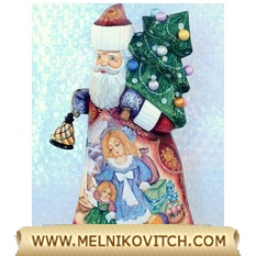Santa Claus sculture with Christmas tree and torch