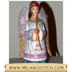 Archangel Gabriel - wooden angel figurine with a trumpet